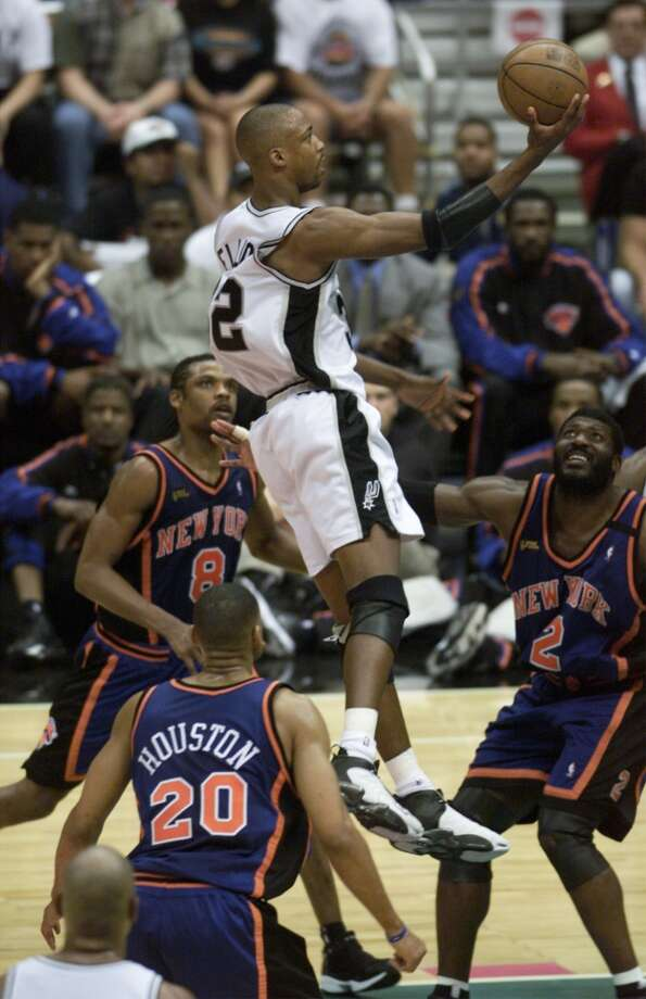Sean Elliott helped the Spurs to their first title in the season of his Memorial Day Miracle earlier in the playoffs. He skies over Allan Houston, Larry Johnson and Latrell Sprewell of the Knicks during the third quarter of Game 1 of the 1999 NBA Finals on June 16, 1999 at the Alamodome.