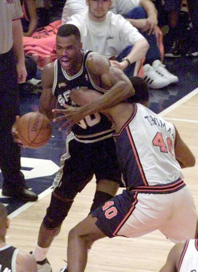 The Spurs' David Robinson (50) has a tough time driving past the defense of Knick's Kurt Thomas (40) during Game 4 of the NBA Finals Wednesday June 23, 1999 at Madison Square Garden in New York City.