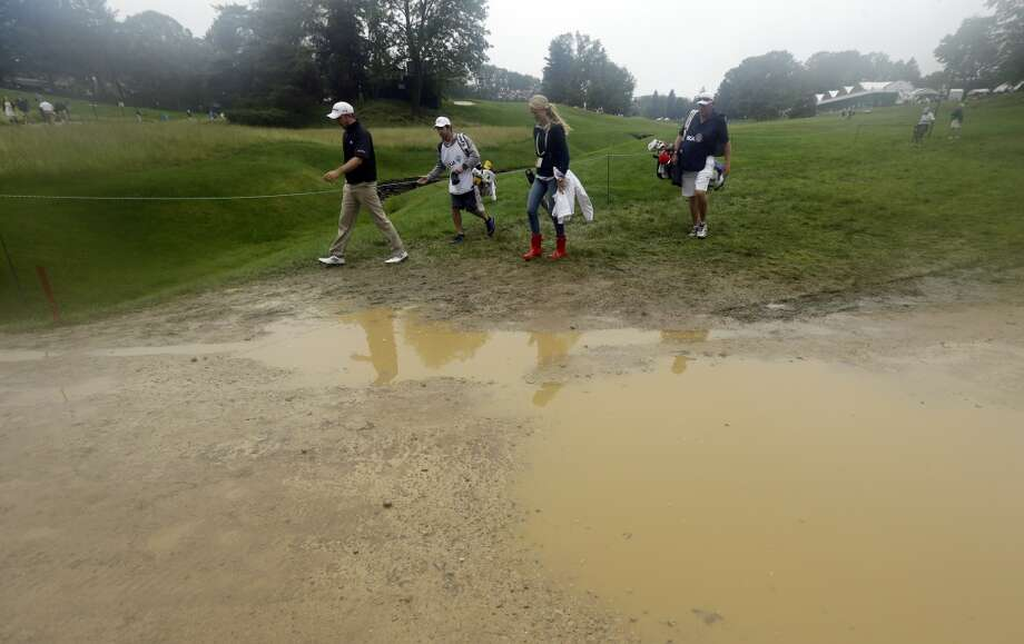 Martin Laird, left, of Scotland, walks near the fifth hole during the first round of the U.S. Open golf tournament at Merion Golf Club, Thursday, June 13, 2013, in Ardmore, Pa. (AP Photo/Julio Cortez)