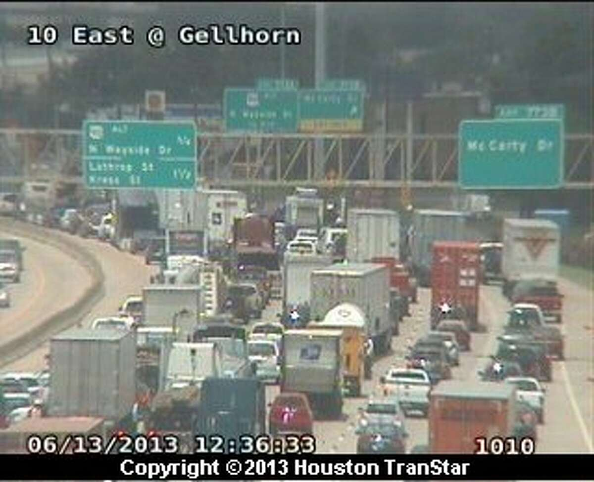 Traffic was snarled after a wreck led to a Hazmat spill on the westbound East Freeway near McCarty about 12:20 p.m. Thursday.