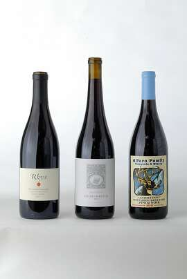 Three bottles of Santa Cruz Mountain Pinot Noir left-tight: 2011 Rhys Horseshoe Vineyard Pinot Noir, 2011 Ghostwriter Pinot Noir, 2011 Alfaro Family Vineyards Lester Family Vineyards at Deer Park Pinot Noir as seen in San Francisco, California, on June 12, 2013.