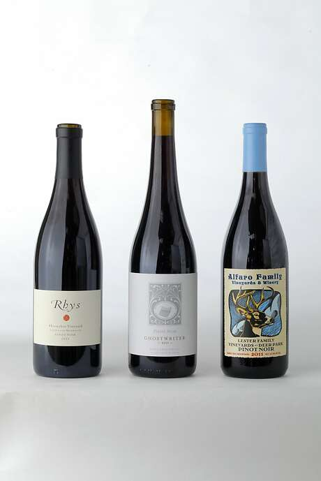 Three bottles of Santa Cruz Mountain Pinot Noir left-tight: 2011 Rhys Horseshoe Vineyard Pinot Noir, 2011 Ghostwriter Pinot Noir, 2011 Alfaro Family Vineyards Lester Family Vineyards at Deer Park Pinot Noir as seen in San Francisco, California, on June 12, 2013. Photo: Craig Lee, Special To The Chronicle