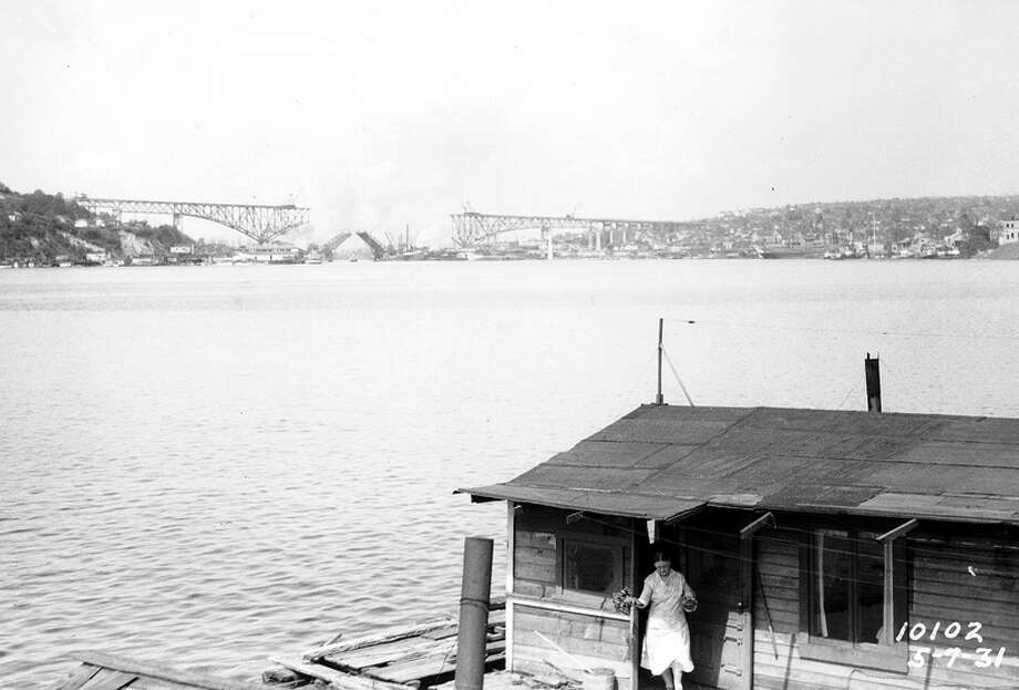 Lake Union, 1931, with the Aurora Bridge under construction.  Photo: Seattle Municipal Archives, /