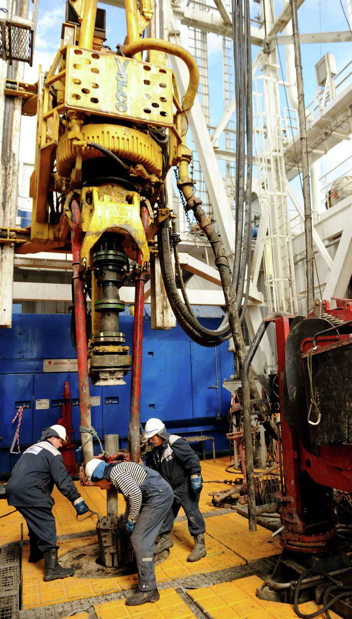 Drillers work an average of 59 hours a week. (Photo credit should read MIKHAIL MORDASOV/AFP/Getty Images)