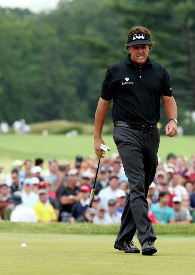 ARDMORE, PA - JUNE 13:  Phil Mickelson of the United States reacts on the 18th hole during Round One of the 113th U.S. Open at Merion Golf Club on June 13, 2013 in Ardmore, Pennsylvania. Photo: Andrew Redington, Getty Images / 2013 Getty Images