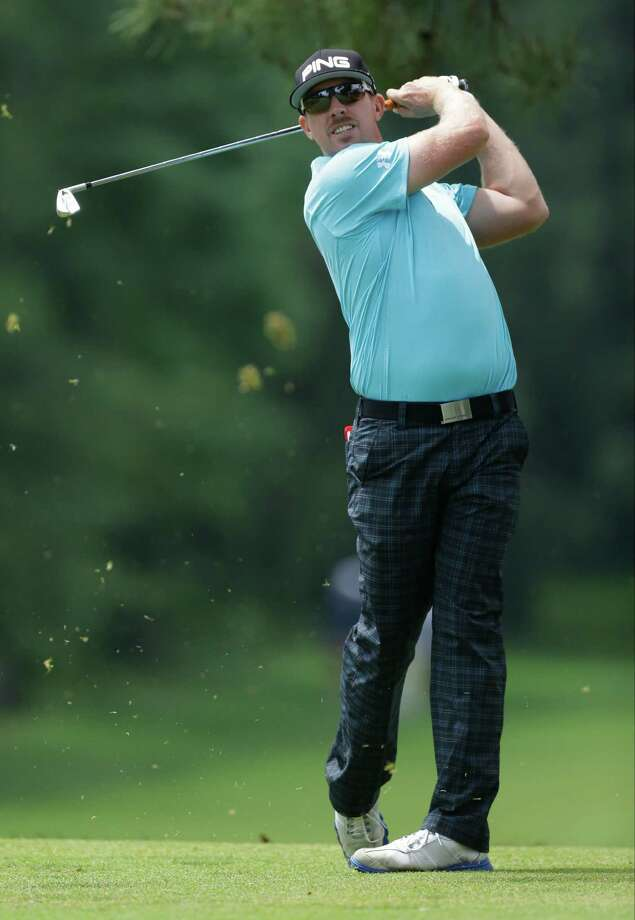 Hunter Mahan tees off on the eighth hole during the first round of the U.S. Open golf tournament at Merion Golf Club, Thursday, June 13, 2013, in Ardmore, Pa. (AP Photo/Julio Cortez) Photo: Julio Cortez, Associated Press / AP