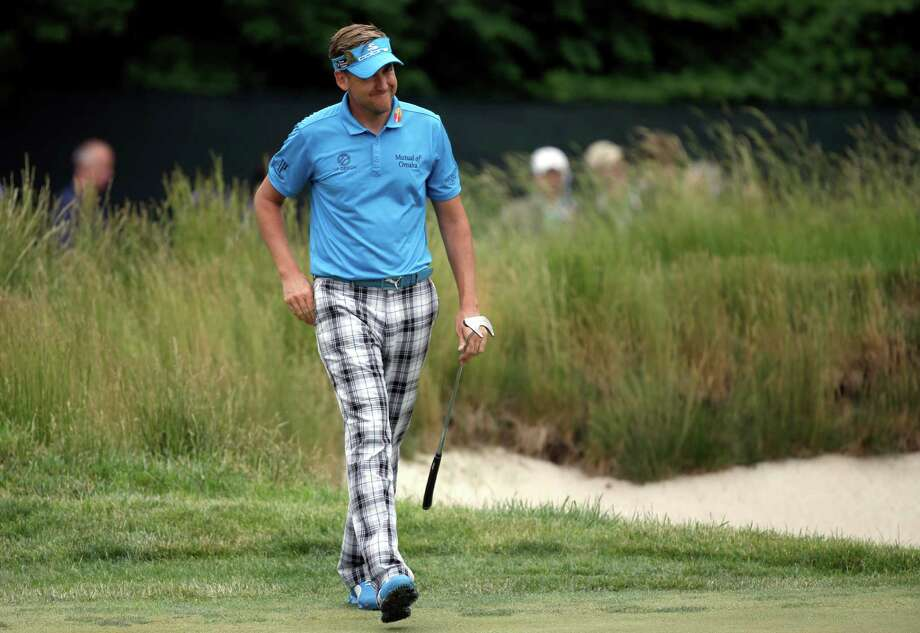 Ian Poulter, of England, reacts after putting for bogey on the 17th hole during the first round of the U.S. Open golf tournament at Merion Golf Club, Thursday, June 13, 2013, in Ardmore, Pa. (AP Photo/Morry Gash) Photo: Morry Gash, Associated Press / AP