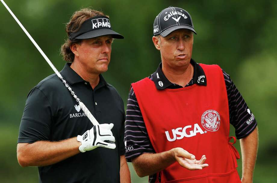 ARDMORE, PA - JUNE 13:  Phil Mickelson of the United States and his caddie Jim MacKay discuss a tee shot during Round One of the 113th U.S. Open at Merion Golf Club on June 13, 2013 in Ardmore, Pennsylvania. Photo: Scott Halleran, Getty Images / 2013 Getty Images