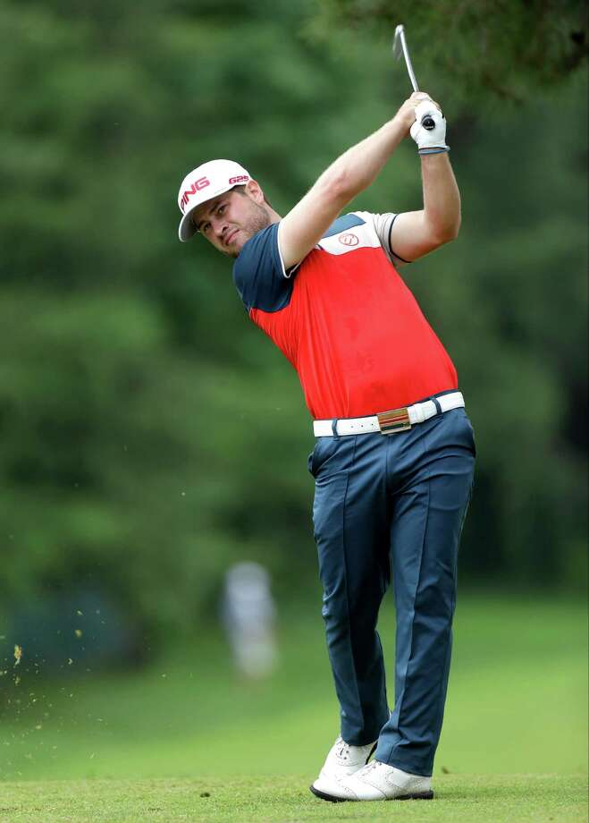 David Lingmerth, of Sweden, tees off on the eighth hole during the first round of the U.S. Open golf tournament at Merion Golf Club, Thursday, June 13, 2013, in Ardmore, Pa. (AP Photo/Julio Cortez) Photo: Julio Cortez, Associated Press / AP