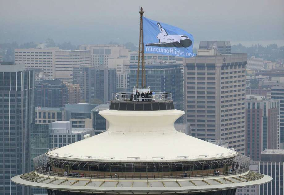 A Museum of Flight flag flies on the Space Needle on Sept. 29, 2010, during the city's bid for a retired space shuttle. Photo: Joshua Trujillo, AP / Seattlepi.com