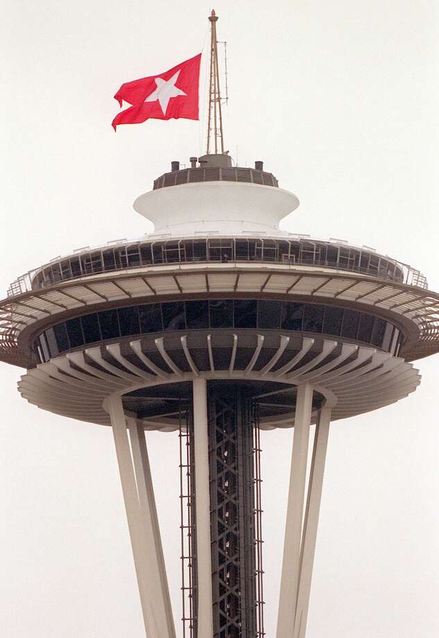 A replica of the Titanic's White Star Line flag flies at half-staff on the Space Needle, during a moment of silence at the Pacific Science Center's Titanic exhibit for the steamship victims on April 12, 2001. Photo: RENEE C. BYER, SEATTLE POST INTELLIGENCER