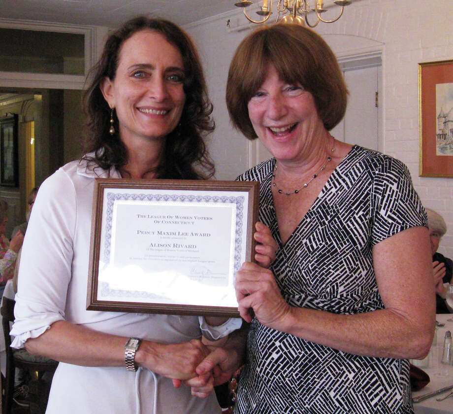 Alison Rivard of the League of Women Voters of Westport, right, receives the Percy Maxim Lee Award from Cheryl Dunson, president of the League of Women Voters of Connecticut. Rivard was cited by the state organization for her work in getting the state legislature to pass gun-control legislation. Photo: Contributed Photo / Westport News