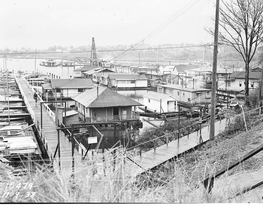 The 1930s brought a surge in people scrounging for cheap  housing, which they found in shacks that floated on  cedar logs. Photo of Portage Bay, 1938.  Photo: Seattle Municipal Archives