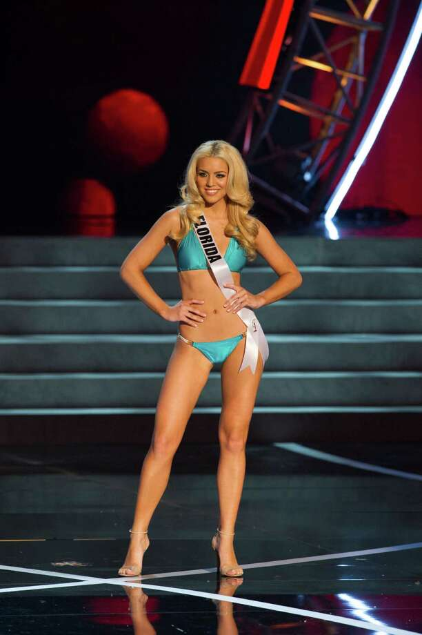 In this photo provided by the Miss Universe Organization,  Miss Florida USA 2013, Michelle Aguirre,  competes in her swimsuit during the  2013 Miss USA Competition Preliminary Show in Las Vegas on Wednesday June 12, 2013.   She will compete for the title of Miss USA 2013 and the coveted Miss USA Diamond Nexus Crown on June 16, 2013.  (AP Photo/Miss Universe Organization, Darren Decker) Photo: Darren Decker, Associated Press / Miss Universe Organization