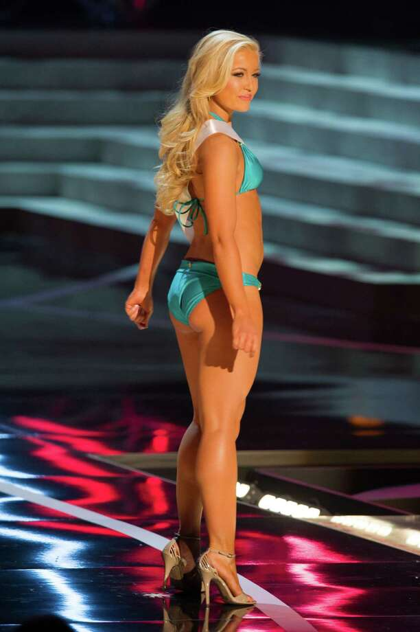 In this photo provided by the Miss Universe Organization,  Miss Idaho USA 2013, Marissa Wickland,  competes in her swimsuit during the  2013 Miss USA Competition Preliminary Show in Las Vegas on Wednesday June 12, 2013.   She will compete for the title of Miss USA 2013 and the coveted Miss USA Diamond Nexus Crown on June 16, 2013.  (AP Photo/Miss Universe Organization, Darren Decker) Photo: Darren Decker, Associated Press / Miss Universe Organization