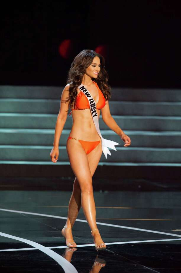 In this photo provided by the Miss Universe Organization,  Miss New Jersey USA 2013, Libell Duran,  competes in her swimsuit during the  2013 Miss USA Competition Preliminary Show in Las Vegas on Wednesday June 12, 2013.   She will compete for the title of Miss USA 2013 and the coveted Miss USA Diamond Nexus Crown on June 16, 2013.  (AP Photo/Miss Universe Organization, Darren Decker) Photo: Darren Decker, Associated Press / Miss Universe Organization