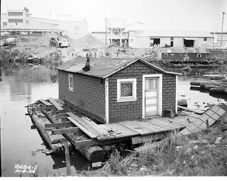 The Duwamish River was also home to many houseboaters, who were largely working-class residents. Note the typical cedar-log float of the time. (Photo, 1954).  Photo: Seattle Municipal Archives
