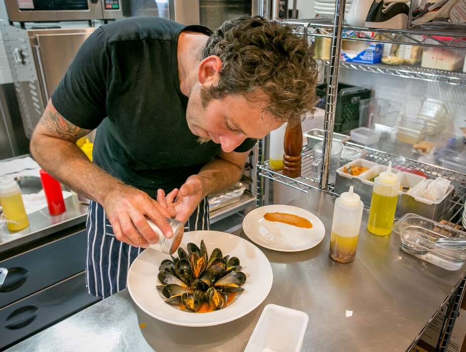 Chef Augustin Elbert prepares the mussels in broth.