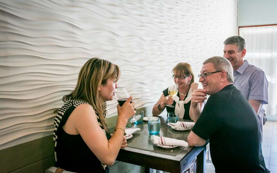 People enjoy dinner at Donostia.