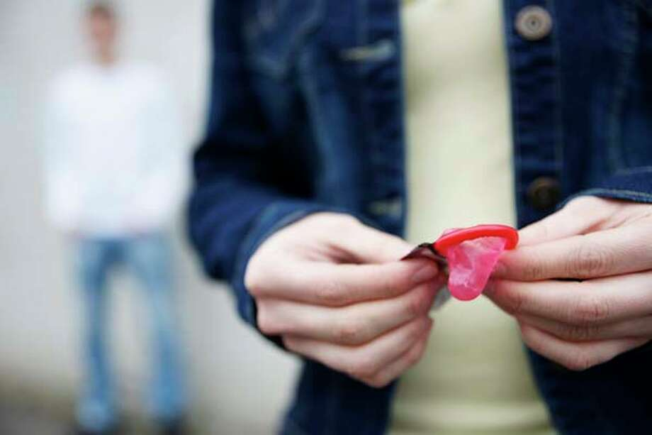 """The good news is teens are using condoms. The bad news is they're inhaling them through their nose and pulling them out their mouth while trying not to choke. It's called the """"condom challenge.""""  Side effects include possible suffocation and sinus damage. Photo: Uwe Umstätter, Getty Images/Imagebroker RF / Imagebroker RF"""