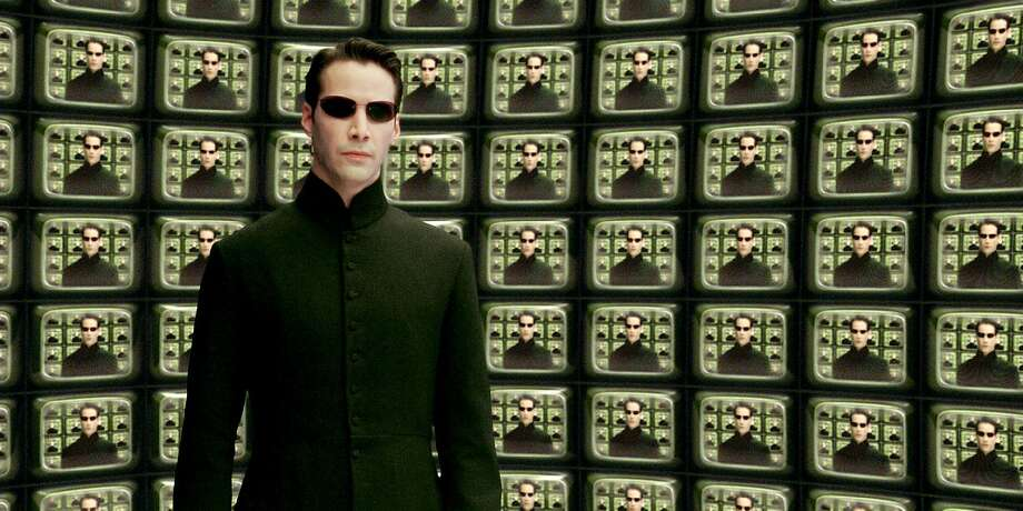 The MatrixA computer programmer turned hacker at night starts to work with a terrorist. 