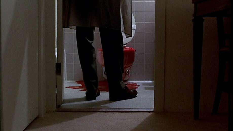 "The ConversationGene Hackman is the paranoid surveillance expert in the 1974 Coppola movie ""The Conversation"". When starting to suspect a couple he is set to spy on will be murdered he has a crises. Here his character Harry Caul sees the 'clean' toilet suddenly backing up with bloody evidence."