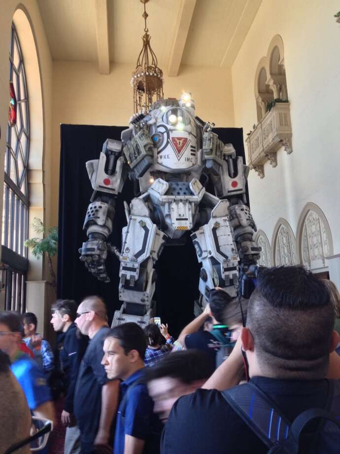 "A large visitor from ""Titanfall"" greets people who attended Electronic Arts' E3 media preview at the Shrine Auditorium"