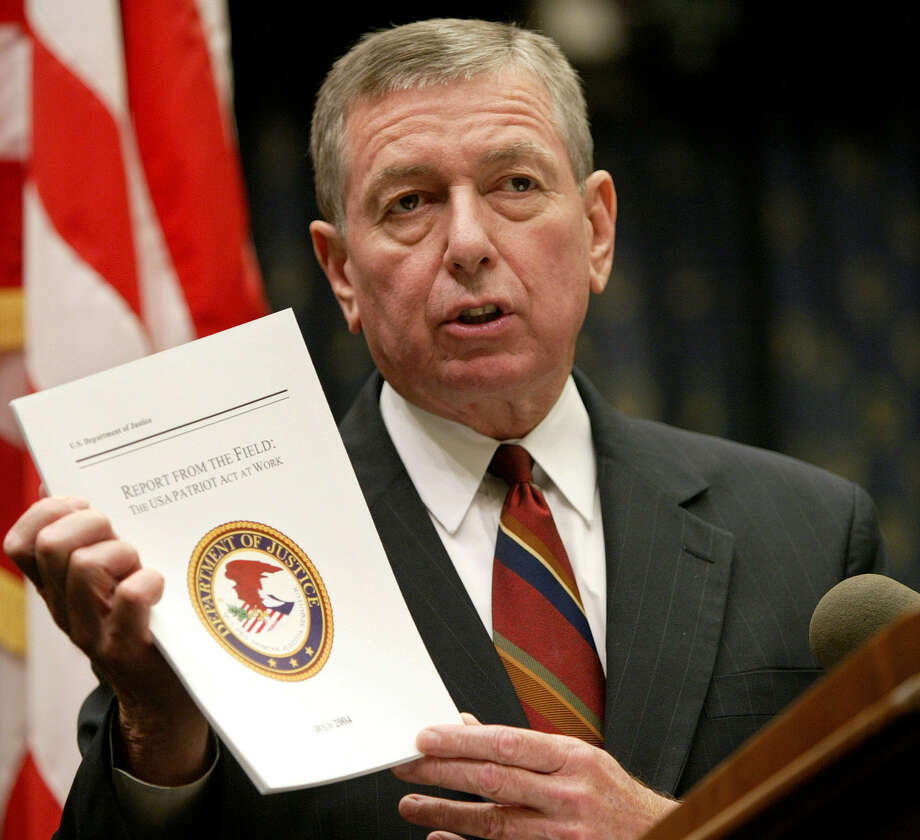 "Then-U.S. Attorney General John Ashcroft holds  a  ""Patriot Act at Work"" report in 2004. Good intentions, it seems, have served to undermine some of our freedoms. Photo: File Photo, Associated Press"