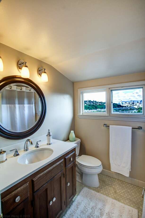 Bathroom of 1706 Magnolia Way W. The 4,890-square-foot house, built in 1900, has four bedrooms, 3.25 bathrooms, a two-story great room, a courtyard, a patio, a deck, and views of Elliott Bay, downtown Seattle and Mount Rainier on a 0.4-acre lot. It's listed for $1.45 million. Photo: Courtesy Scott And Molly Shutes, Windermere Real Estate