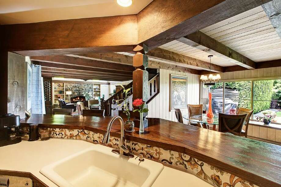Kitchen of 1706 Magnolia Way W. The 4,890-square-foot house, built in 1900, has four bedrooms, 3.25 bathrooms, a two-story great room, a courtyard, a patio, a deck, and views of Elliott Bay, downtown Seattle and Mount Rainier on a 0.4-acre lot. It's listed for $1.45 million. Photo: Courtesy Scott And Molly Shutes, Windermere Real Estate