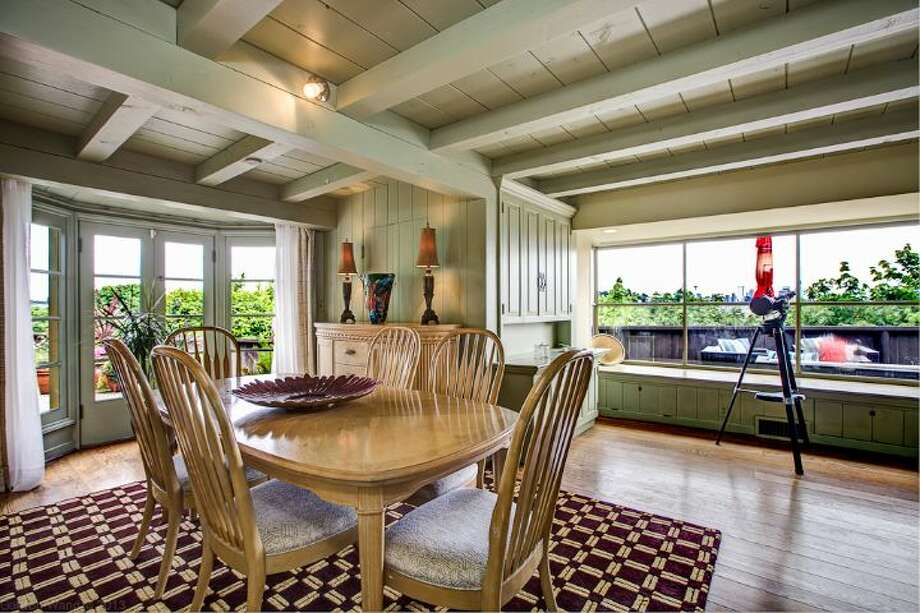 Dining room of 1706 Magnolia Way W. The 4,890-square-foot house, built in 1900, has four bedrooms, 3.25 bathrooms, a two-story great room, a courtyard, a patio, a deck, and views of Elliott Bay, downtown Seattle and Mount Rainier on a 0.4-acre lot. It's listed for $1.45 million. Photo: Courtesy Scott And Molly Shutes, Windermere Real Estate