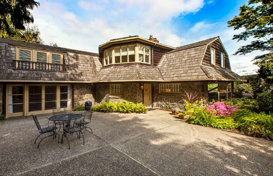This weeks spotlight home, 1706 Magnolia Way W., attracted our attention with its chateau-like feel. The 4,890-square-foot house, built in 1900, has four bedrooms, 3.25 bathrooms, a two-story great room, a courtyard, a patio, a deck, and views of Elliott Bay, downtown Seattle and Mount Rainier on a 0.4-acre lot. It's listed for $1.45 million. Photo: Courtesy Scott And Molly Shutes,  Windermere Real Estate