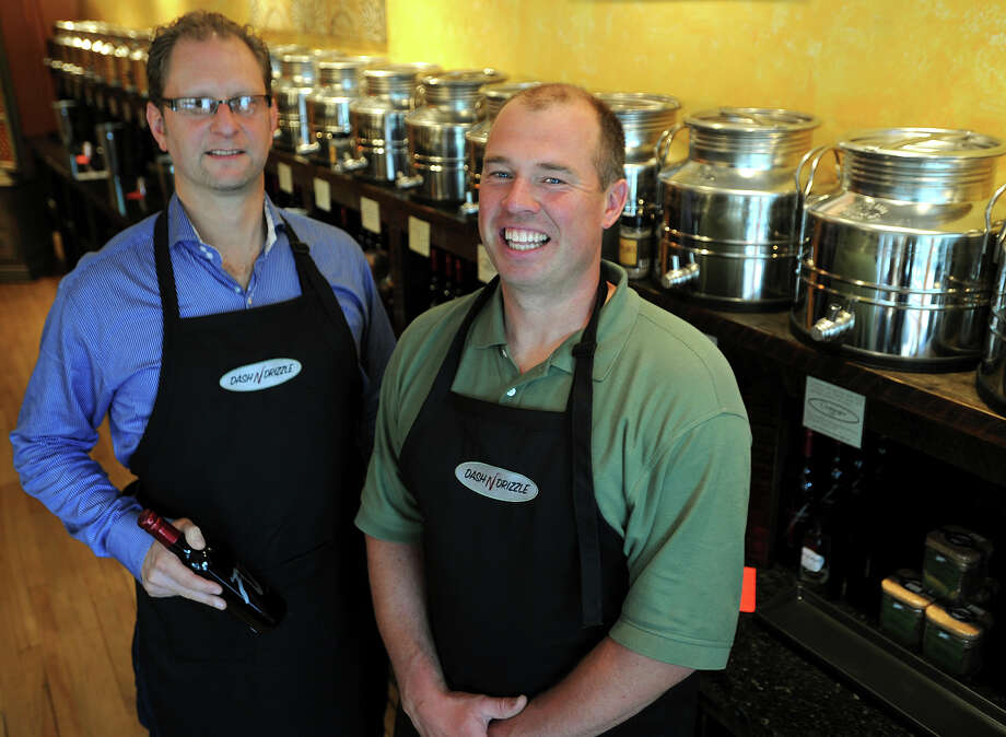 Jeff Stein, left, and Jeff Love, co-owners of the new Dash 'N Drizzle, an olive oil and balsamic vinegar specialty store, at 11 Unquowa Road in downtown Fairfield on Thursday, June 13, 2013. Photo: Brian A. Pounds / Connecticut Post