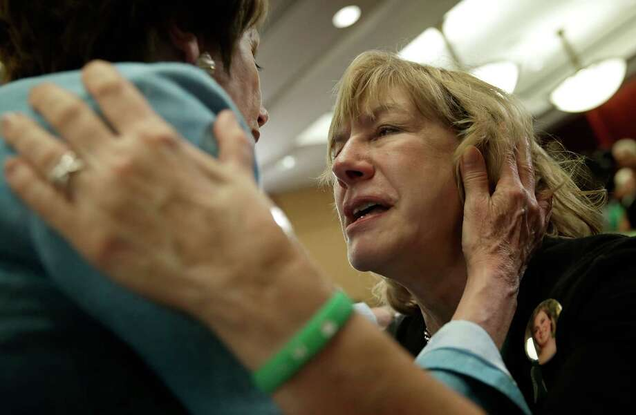 WASHINGTON, DC - JUNE 13:  Teresa Rousseau (R), the mother of school teacher Lauren Rousseau who was killed during the Sandy Hook Elementary School shooting, is hugged by House Minority Leader Nancy Pelosi (D-CA) (L) durina an event marking the six month anniversary of the Newtown, Connecticut shooting at the U.S. Capitol June 13, 2013 in Washington, DC. Friends and family members of the shooting victims joined members of Congress for a day long event to honor the 26 children and educators killed in the December shooting, and to renew calls for gun reform legislation. Photo: Win McNamee, Getty Images / 2013 Getty Images