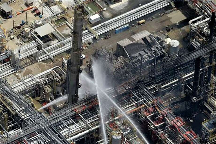 A chemical plant fire is seen in an aerial photo about twenty miles southeast of Baton Rouge, in Geismer, La., Thursday, June 13, 2013. The plant makes highly flammable gases that are basic building blocks in the petrochemical industry. Photo: Gerald Herbert, AP / AP