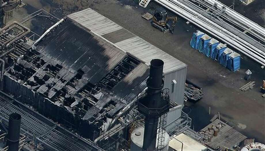 Melted portable toilets are seen at a chemical plant fire in this aerial photo about twenty miles southeast of Baton Rouge, in Geismer, La., Thursday, June 13, 2013. The plant makes highly flammable gases that are basic building blocks in the petrochemical industry. Photo: Gerald Herbert, AP / AP