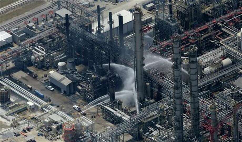 A chemical plant fire is seen in this aerial photo about twenty miles southeast of Baton Rouge, in Geismer, La., Thursday, June 13, 2013.  Early tests did not indicate dangerous levels of any chemicals around the plant, but area residents were told to remain indoors with doors and windows closed, said Jean Kelly, spokeswoman for the state Department of Environmental Quality. Photo: Gerald Herbert, AP / AP