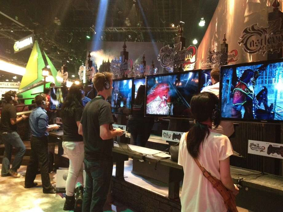 "Players check out the latest ""Castlevania"" at the Konami booth at E3"