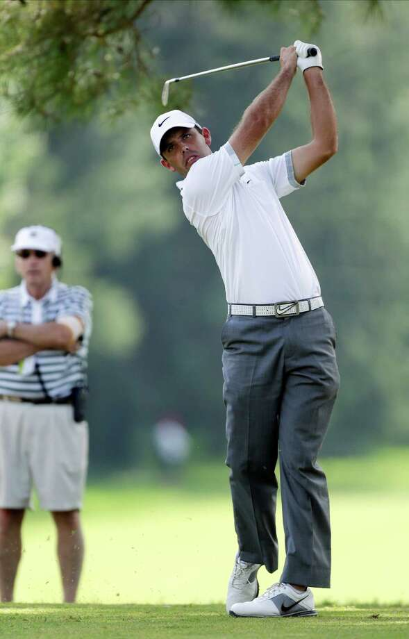 Charl Schwartzel, of South Africa, tees off on the eighth hole during the first round of the U.S. Open golf tournament at Merion Golf Club, Thursday, June 13, 2013, in Ardmore, Pa. (AP Photo/Julio Cortez) Photo: Julio Cortez, Associated Press / AP