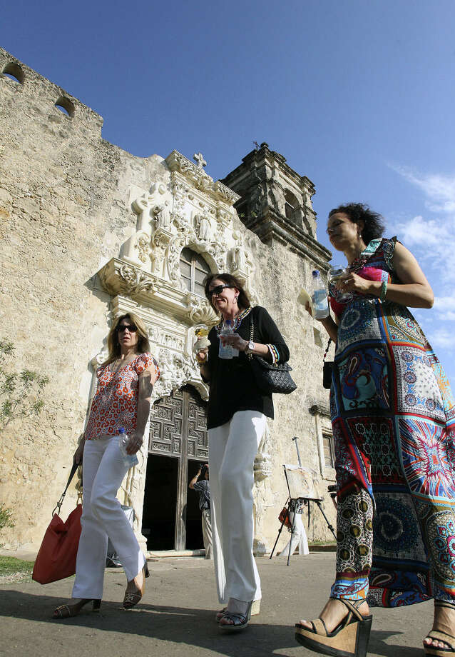 Joan Wyatt (from left), Ruth Agather and Elise Boyan stroll as a large group of symposium attendees visit  San José Mission. Its inclusion on a World Heritage Site list is in jeopardy. Photo: File Photo, San Antonio Express-News