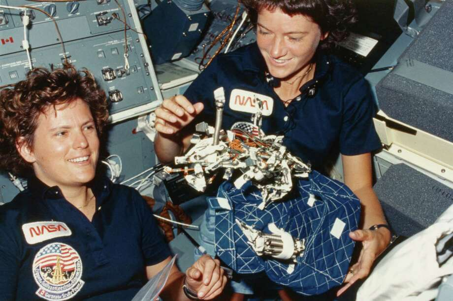 Pretty soon, Ride had female company in space. Here, Ride (right) and astronaut Kathryn Sullivan show off their design for a sleeping bag complete with restraints for zero gravity conditions in Challenger in October 1984. Photo: Space Frontiers, Getty Images / 2012 Getty Images