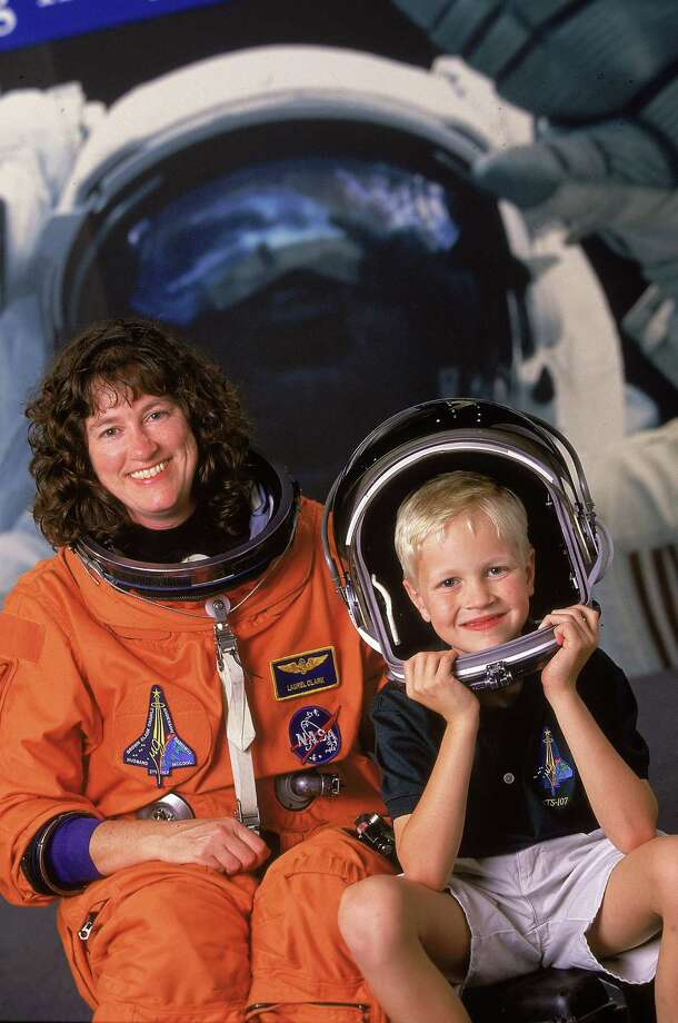 Astronaut Laurel Clark, shown here with then eight-year-old son Ian, was killed with her six crewmates when space shuttle Columbia disintegrated as it re-entered the Earth's atmosphere on February 1, 2003. Photo: Paul S. Howell, Getty Images / Paul S. Howell