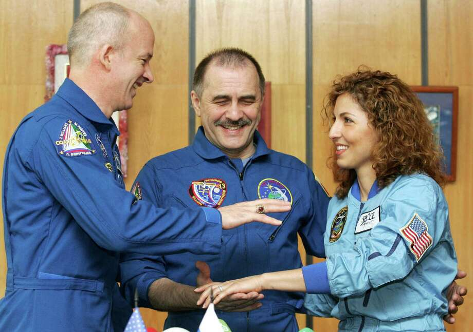 Anousheh Ansari was the first female space tourist, paying her way aboard a Russian capsule in 2006. Photo: ALEXANDER NEMENOV, AFP/Getty Images / 2006 AFP