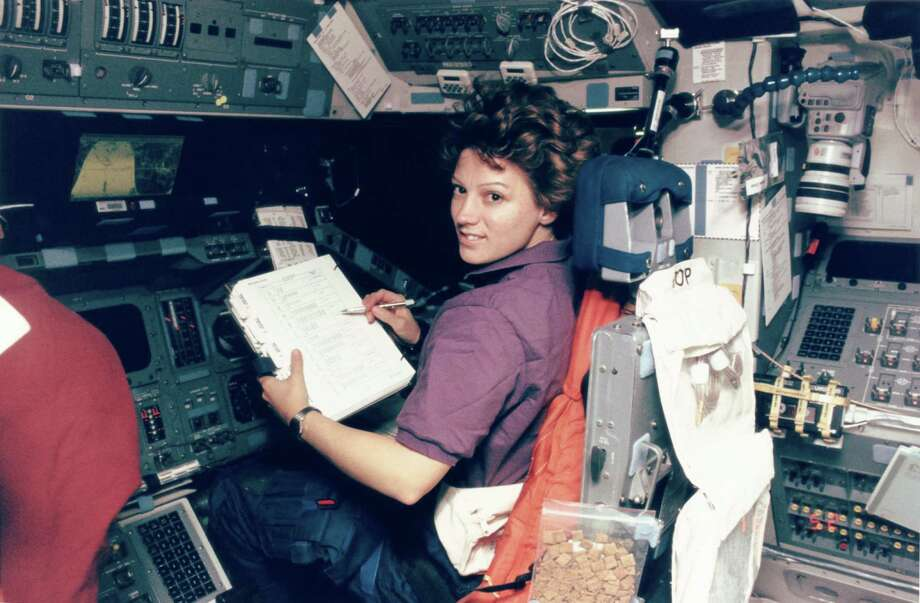 American astronaut Eileen Collins was the first woman to pilot a space shuttle, Discovery, in February 1995. Here she is at her station, as the crew carries out the 'hotfiring' procedure to clear a leaking thruster prior to rendezvous with the Russian Mir space station. Photo: Space Frontiers, Getty Images / 2007 Getty Images