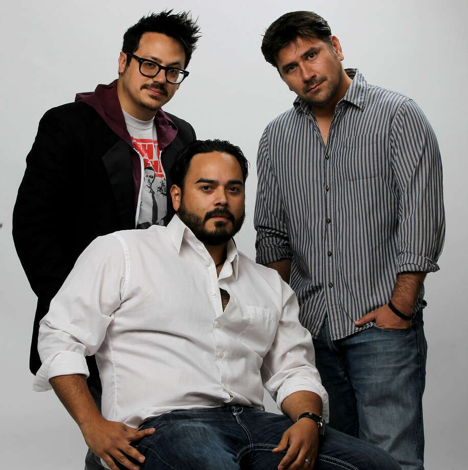 "San Antonio filmmakers Bryan Ortiz (left), Kerry Valderrama (right), and Bryan Ramirez (seated) are co-directors of the psychological thriller ""Sanitarium."" The movie, which is in three parts, is about three people driven to insanity and stars Malcolm McDowell. Photo: John Davenport / San Antonio Express-News"