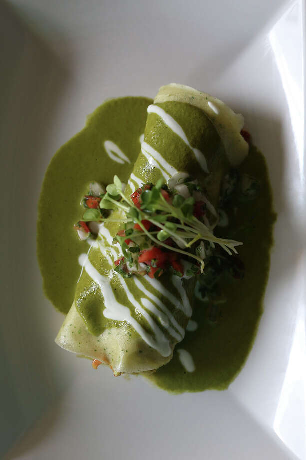 Lobster soft taco with poblano cream sauce has become the signature dish of Arcade Midtown Kitchen owner/chef Jesse Perez. Photo: San Antonio Express-News / San Antonio Express-News