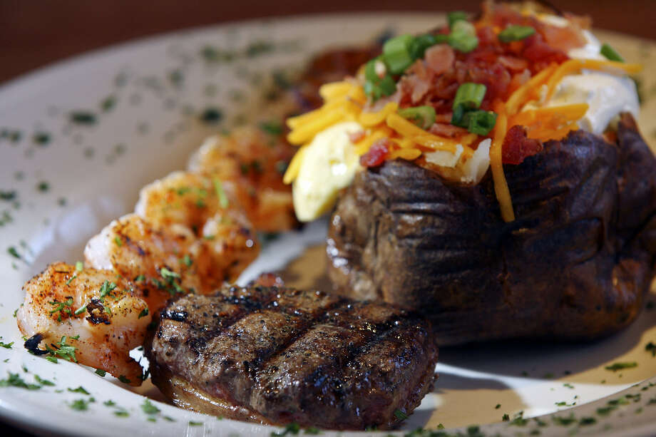 A bacon-wrapped fillet, grilled shrimp kebab and loaded baked potato delight diners at 54th Street Grill & Bar. Photo: Edward A. Ornelas / San Antonio Express-News