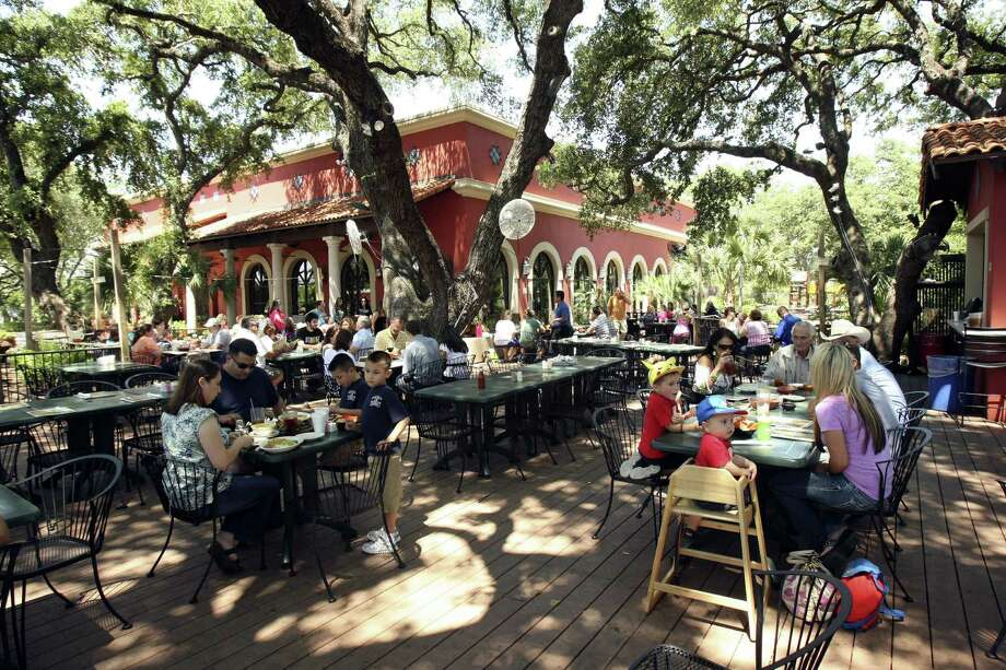 La Hacienda de Los Barrios, with its peaceful patio under shade trees and festive lighting, was voted best restaurant for outdoor dining. Photo: Express-News File Photos