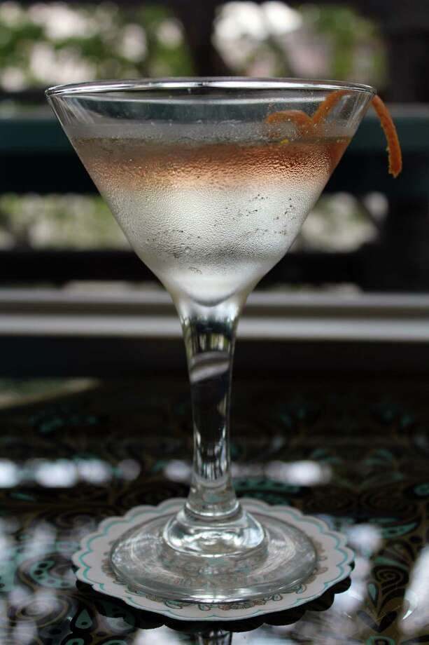 The Cavender Martini at Ocho is made with Cinco Vodka and  St-Germain elderflower liqueur, and topped with sparkling rosé and an orange twist. The cocktail costs $14. Photo: Jennifer McInnis / San Antonio Express-News