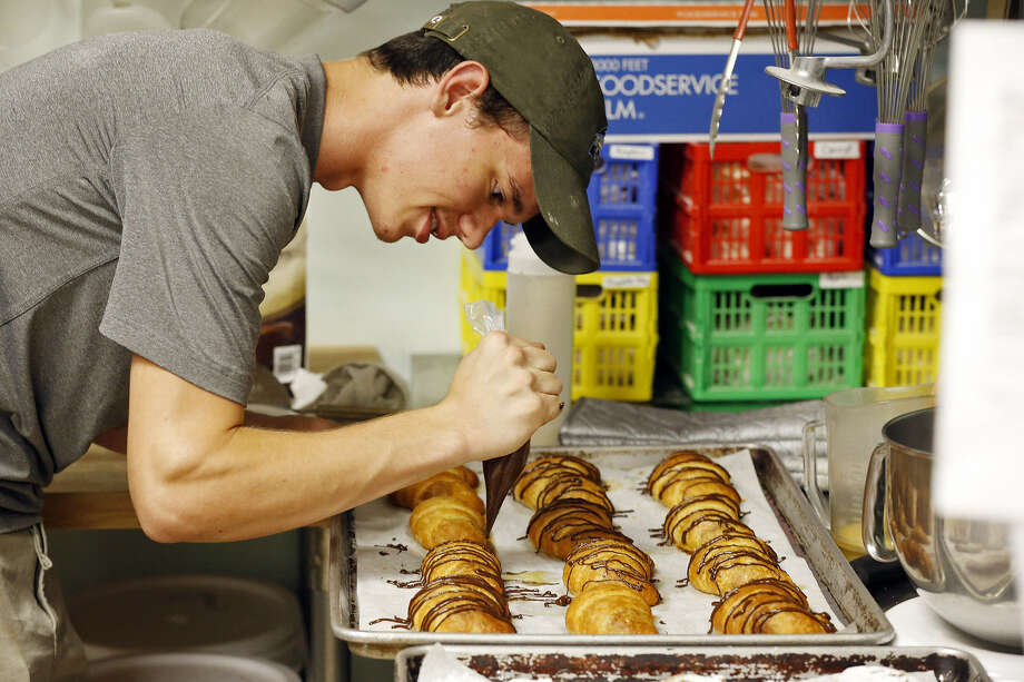 Taylor Becken, founder of C'est La Vie Baking Co., prepares chocolate croissants that he sells at area farmers markets. Photo: Photos By Edward A. Ornelas / San Antonio Express-News